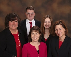 Group picture of attorneys at Law Offices of Cynthia N. Sass, P.A. – center is Cynthia Sass, then left to right, Janet Wise, Ben Briggs, Yvette Everhart, Jennifer Zumarraga